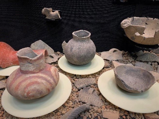 Pottery vessels of various colors that are pieced together and on display in Parkin Archeological State Park's museum.