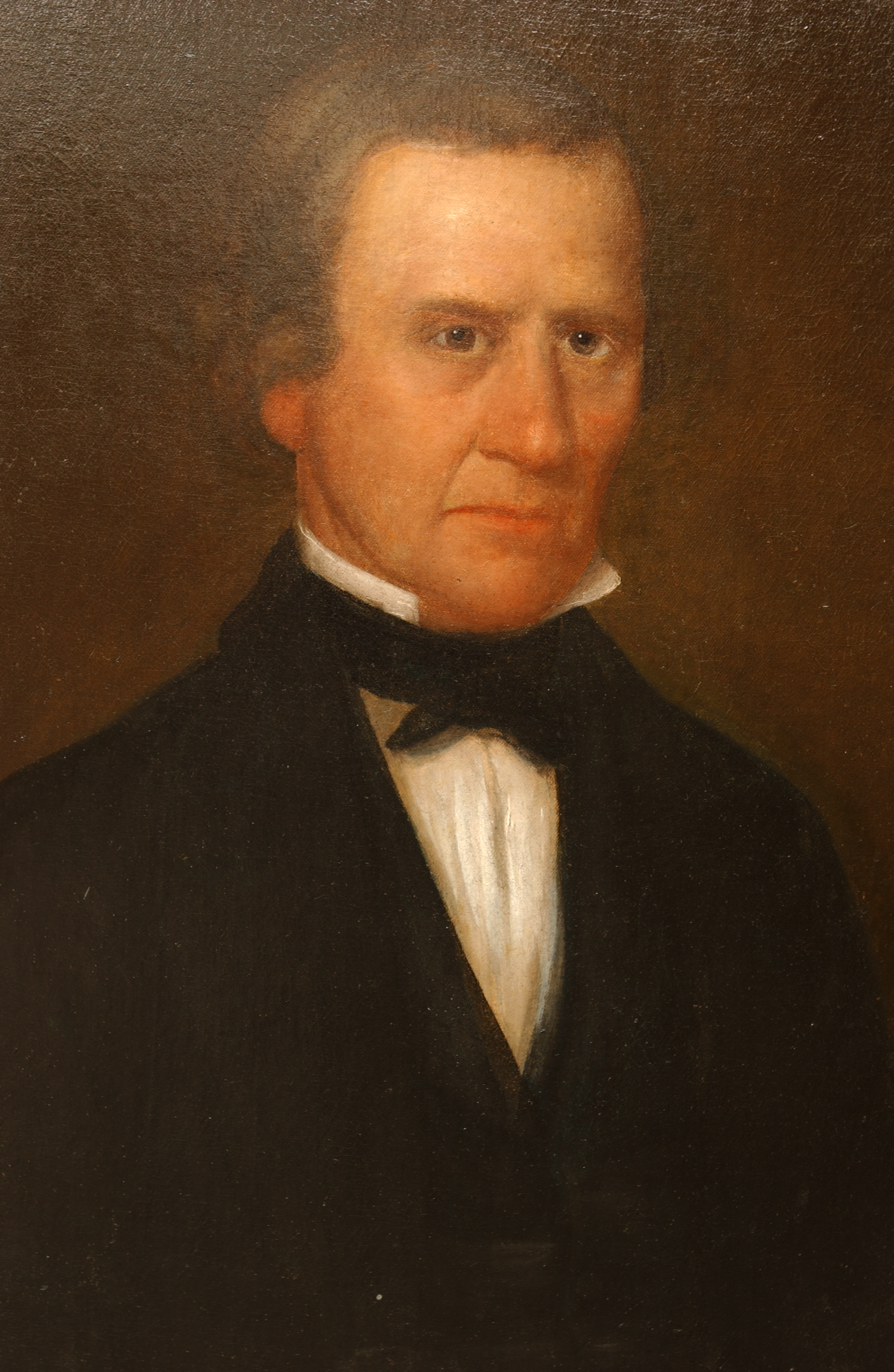 Painted portrait of Cephas Washburn with solemn face, wearing black suit