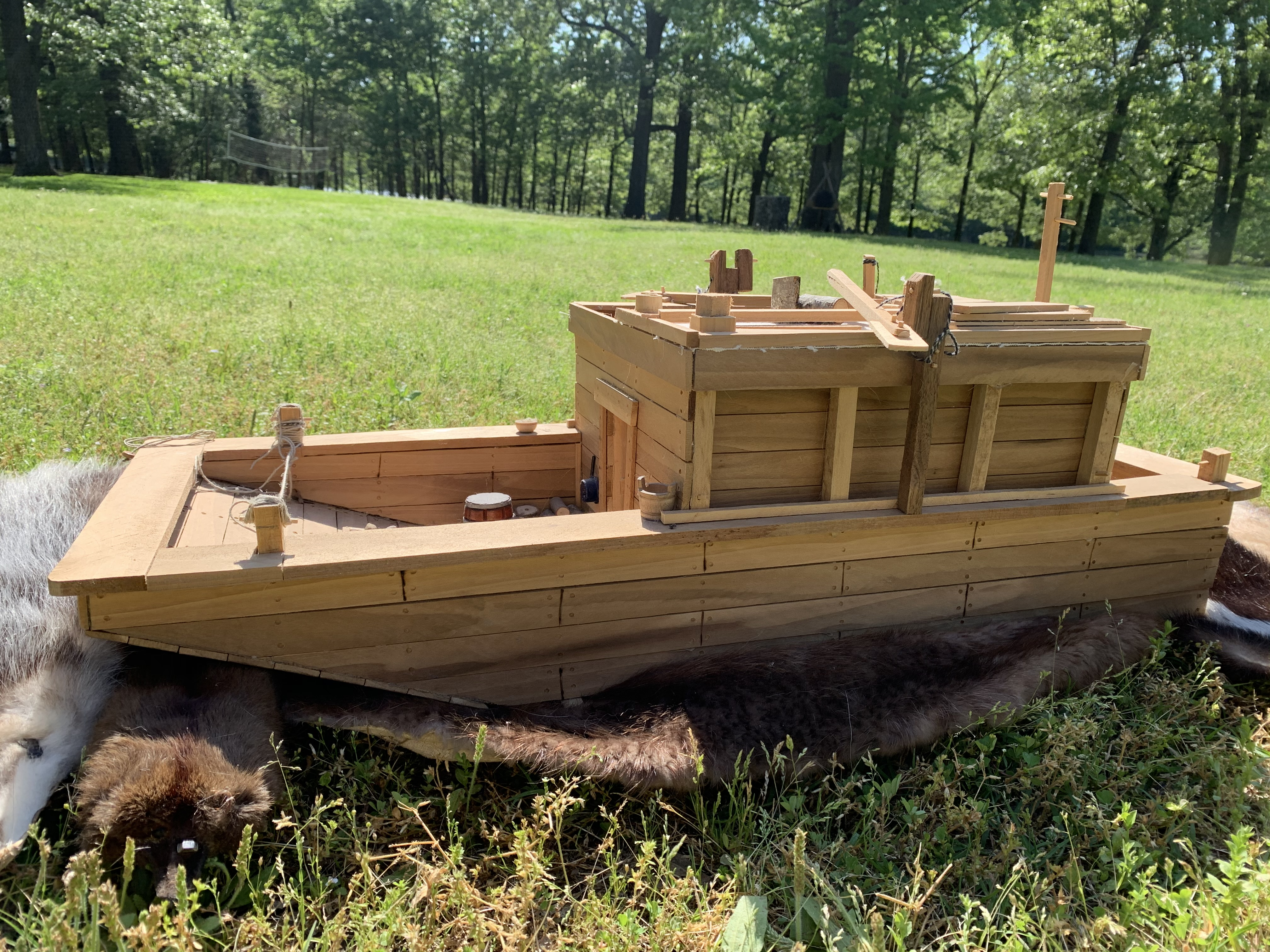 Side view of a small flatboat replica