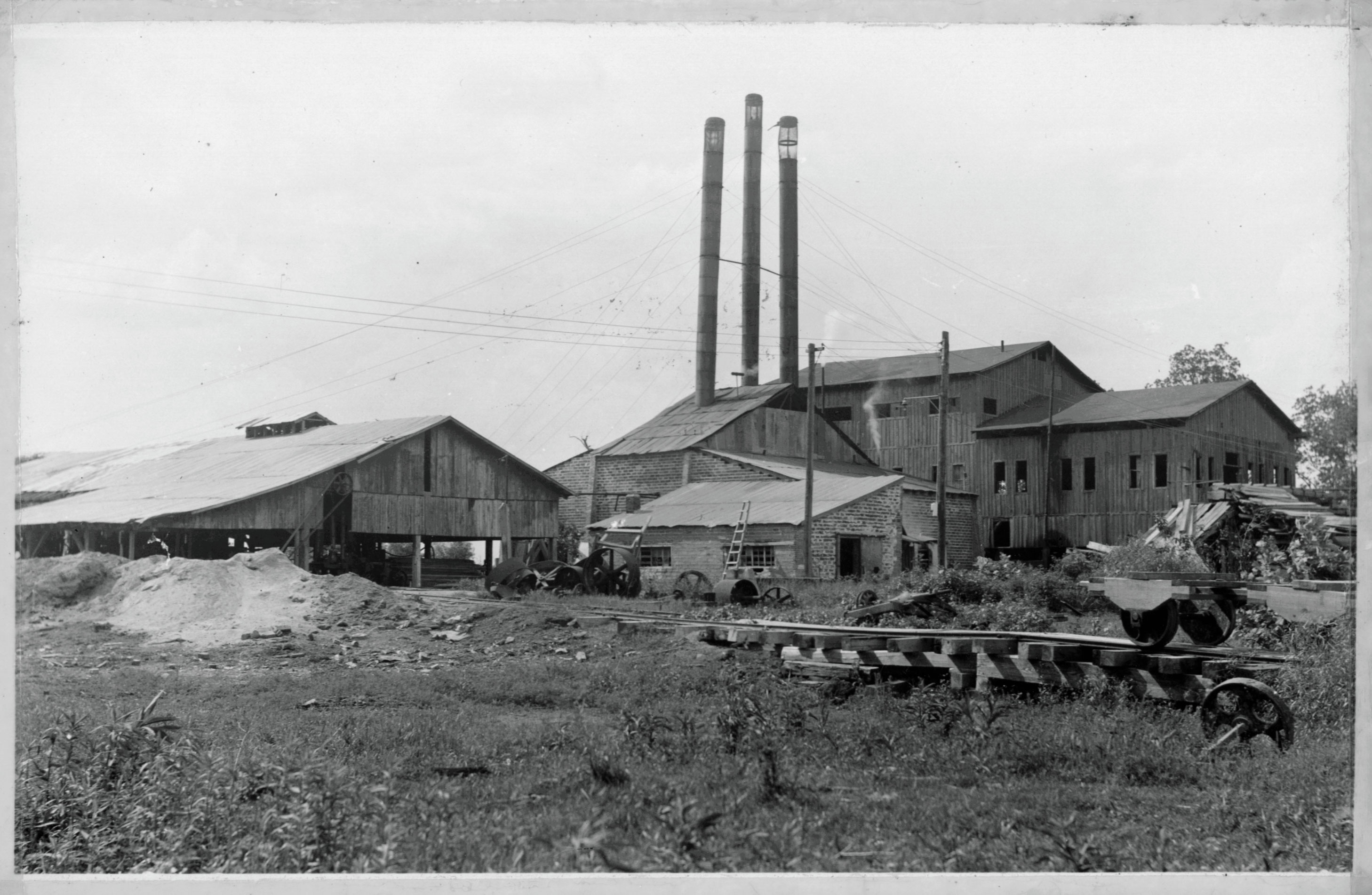 Black and white photograph of the buildings that housed the sawmill that was located on what is now Parkin Archeological State Park.