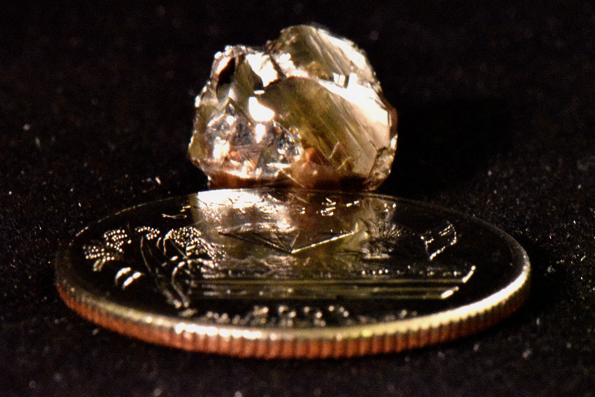 Kinard Friendship Diamond next to quarter for scale