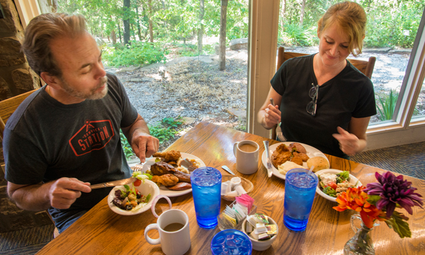 Couple eating delicious fried chicken at the Skillet Restaurant at Ozark Folk Center State Park