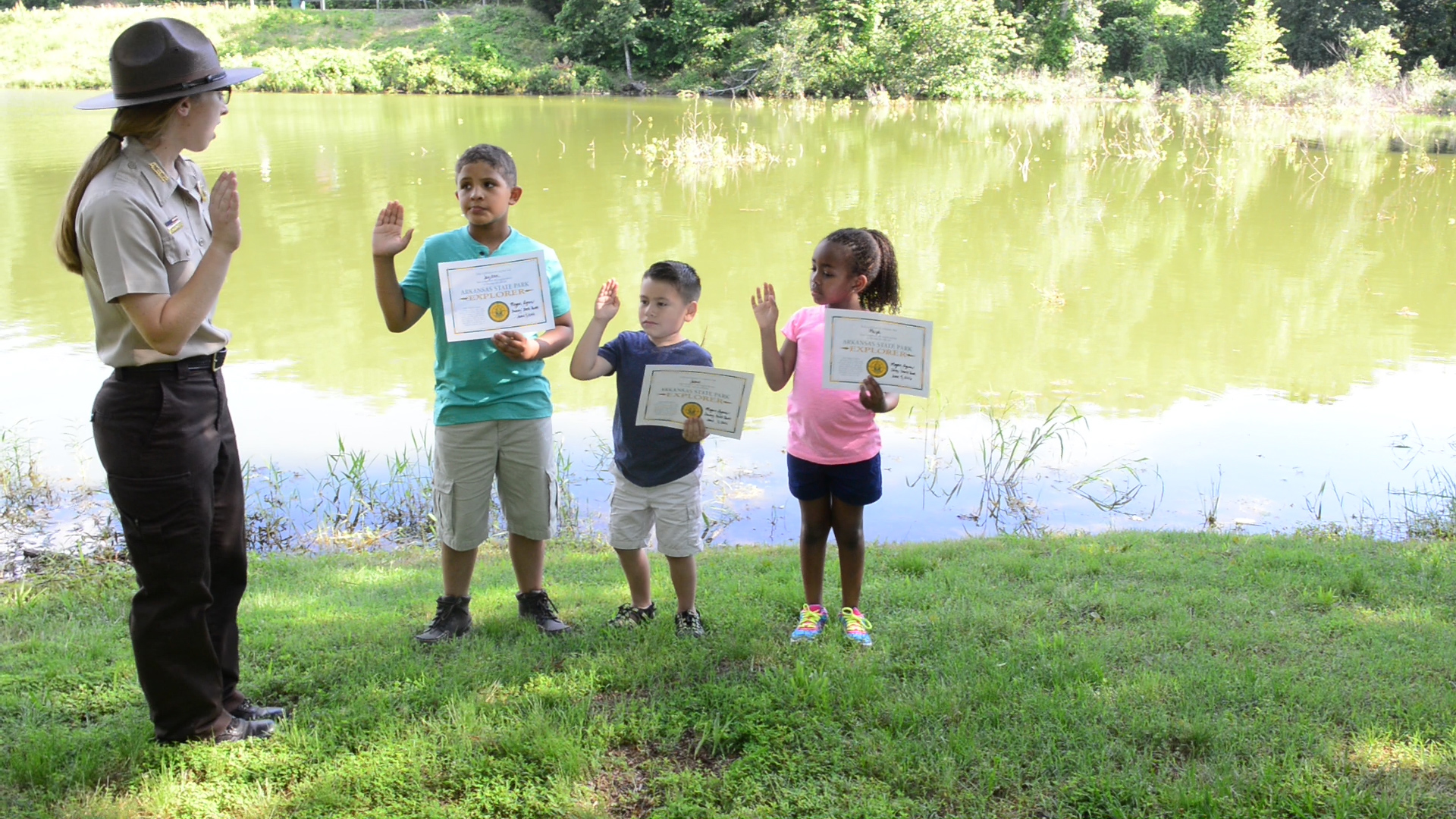Kids taking State Park Explorer pledge