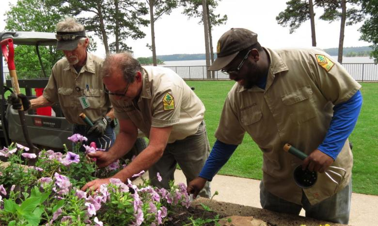 Park Rangers planting flowers in one of our many beautiful state parks