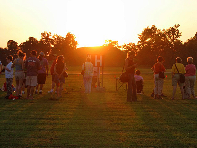 Visitors enjoying the sunset behind Mound A to mark the Fall Equinox.